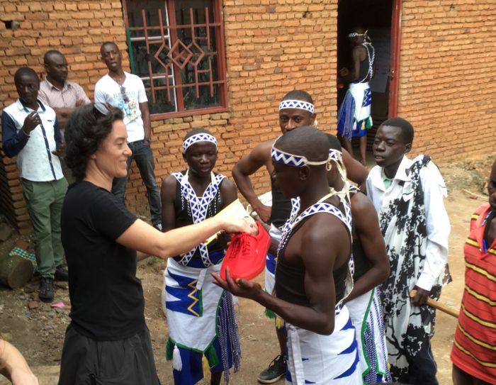 Kara Gilmour shares new shoes with Itorero Amahoro dancers