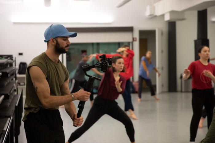 Man filming a dane class.