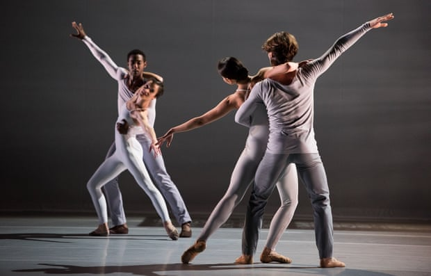 Four people dancing ballet as partners.