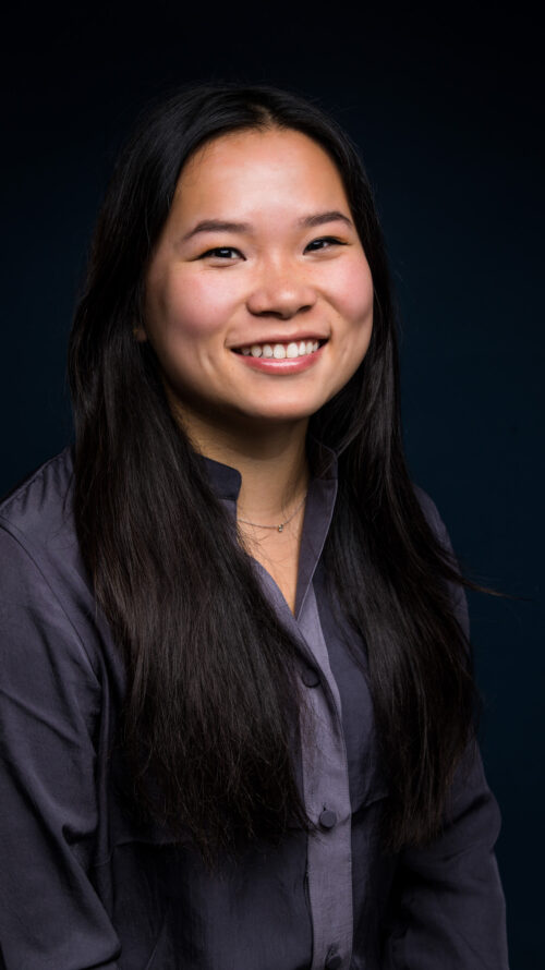 Photo of an asian woman smiling at the camera.